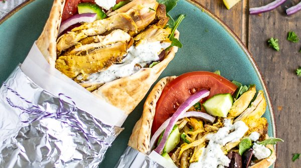 two chicken shawarma wraps on a plate