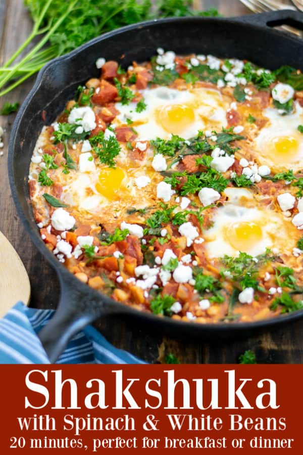This easy recipe for Shakshuka with Spinach & White Beans is perfect for breakfast, lunch, or dinner. Ready in under 20 minutes this is a low-calorie option that is hearty enough to feed and satisfy a family. #plantbased #easy #recipe #healthy #feta #vegetarian #whitebean #breakfast #spinach #shakshuka