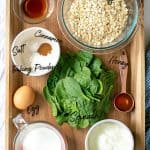 all of the ingredients need to make the pancakes on a wood tray