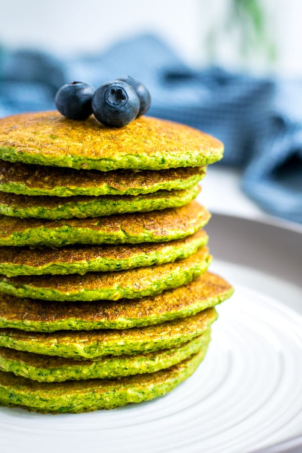 close up of a stack of spinach oatmeal pancakes