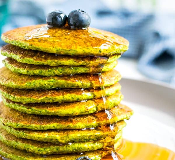 close picture of a stack of green oatmeal packs with syrup drizzling down the side