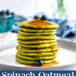 Spinach pancakes in a stack with a drizzle of maple syrup running down the front