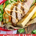 a pork banh mi served with French fries and sriracha mayo