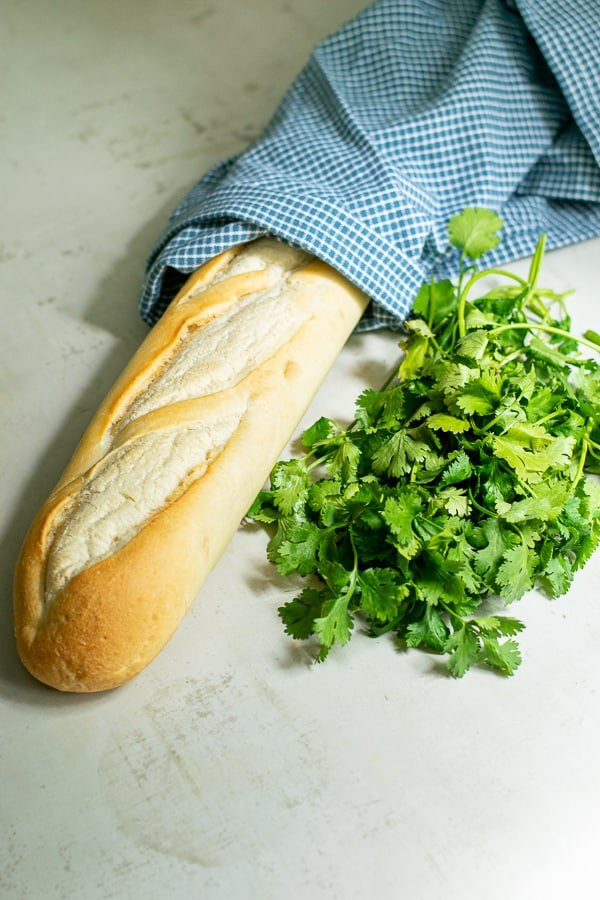 a baguette and a bunch of cilantro for the sandwiches