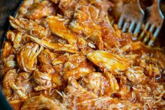 close up of pulled bbq chicken in the slow cooker