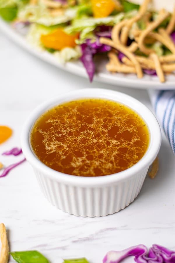 small white bowl filled with homemade sesame vinaigrette dressing