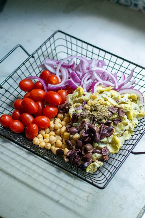 ingredients for chickpea salad in a basket for the grill