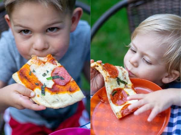 kids enjoying fresh made pepperoni grilled pizza