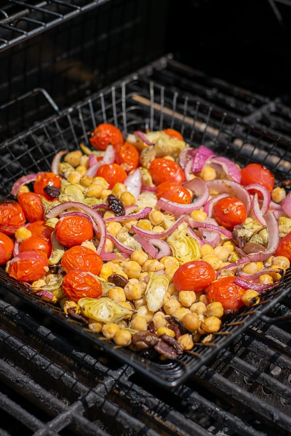 chickpea salad in a grilling basket on the grill