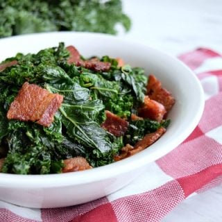 bowl full of sauteed kale and bacon pieces