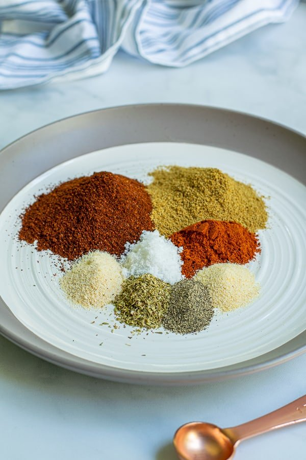plate full of little piles of the spices used to make this taco seasoning simple