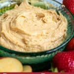 close up of peanut butter dip for fruit in a blue bowl