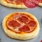 individual pizza on a sheet pan freshly bakes in the oven