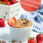 easy chocolate hummus in a white bowl with strawberries