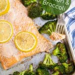 sheet pan salmon and broccoli with a bite on a fork