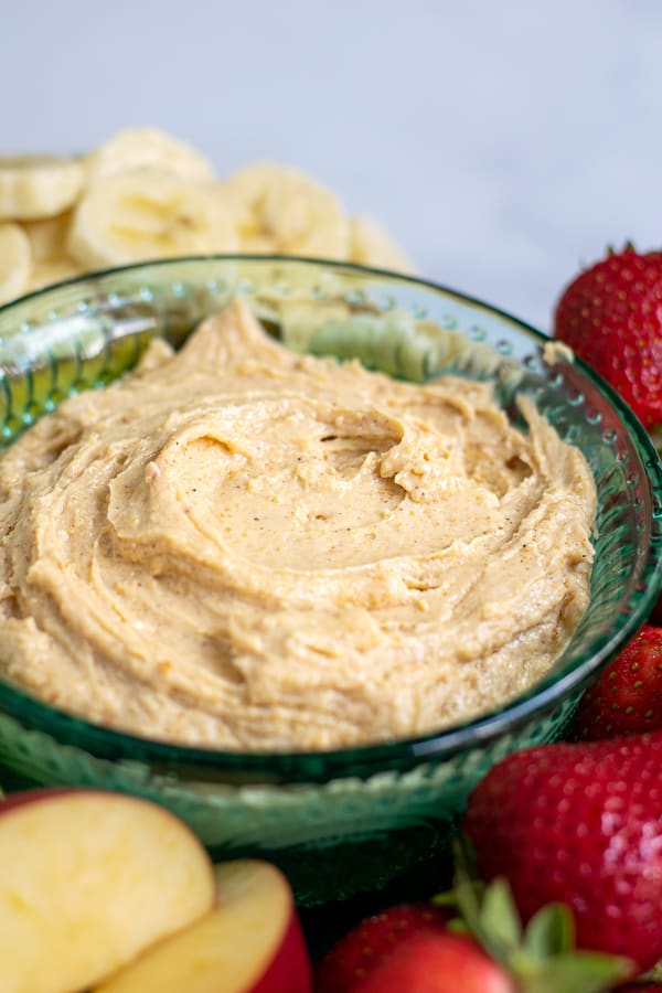 blue bowl filled with whipped peanut butter dip for fruit