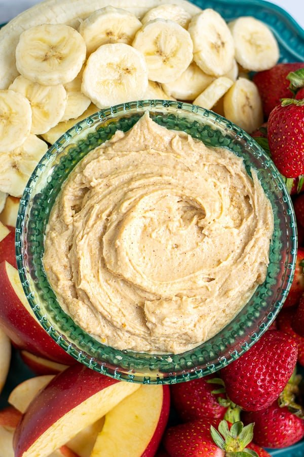 overhead view of a bowl of healthy peanut butter fruit dip