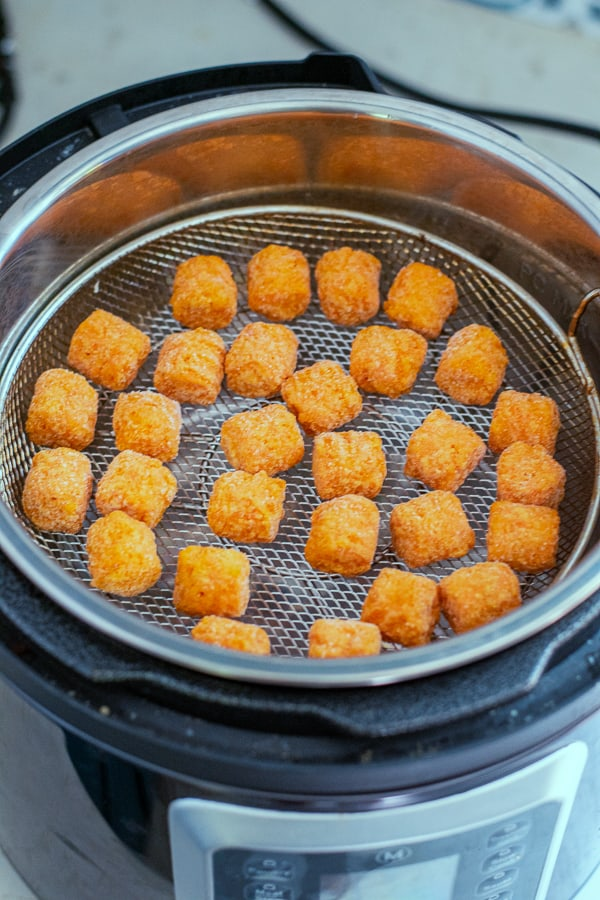 food in the air fryer basket before being cooked