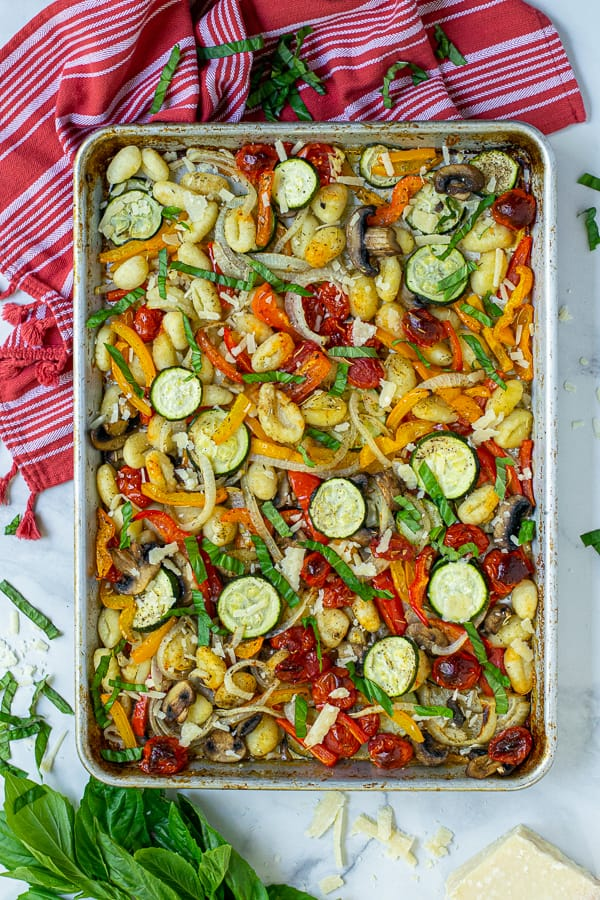baked gnocchi and roasted vegetables on a sheet pan
