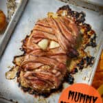 creepy bacon wrapped mummy meatloaf for a halloween dinner idea