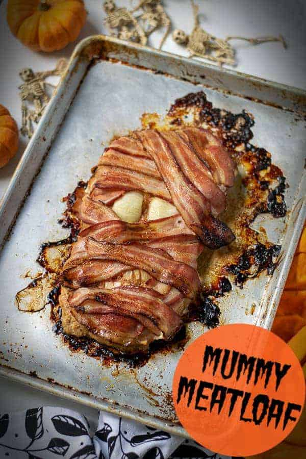 Searching for the perfect Halloween Food Ideas?  Look no further This Mummy Meatloaf for dinner is sure to please kids and adults alike! This spooky and creepy main dish halloween mummy meatloaf is equally gross and delicious! #halloweenfood #mummymeatloaf