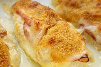 close up of a chicken cordon bleu baked chicken in a casserole dish