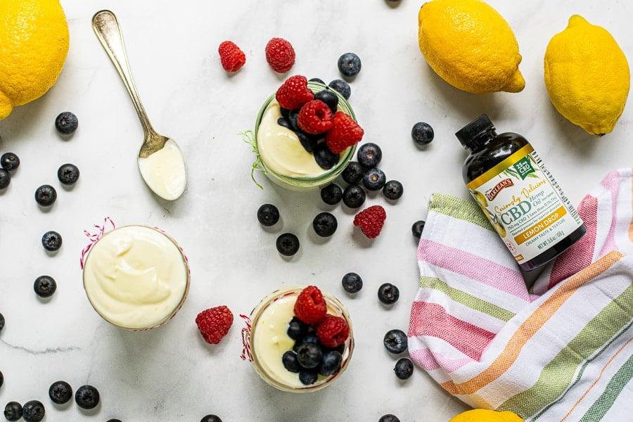 overhead view of jars filled with lemon whipped greek yogurt and Lemon Drop CBD Hemp Oil