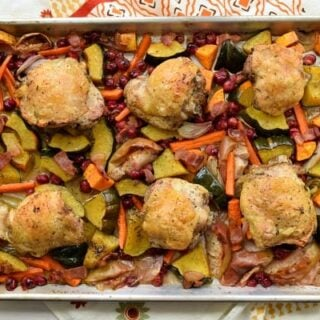 sheet pan with fall vegetables and chicken thighs