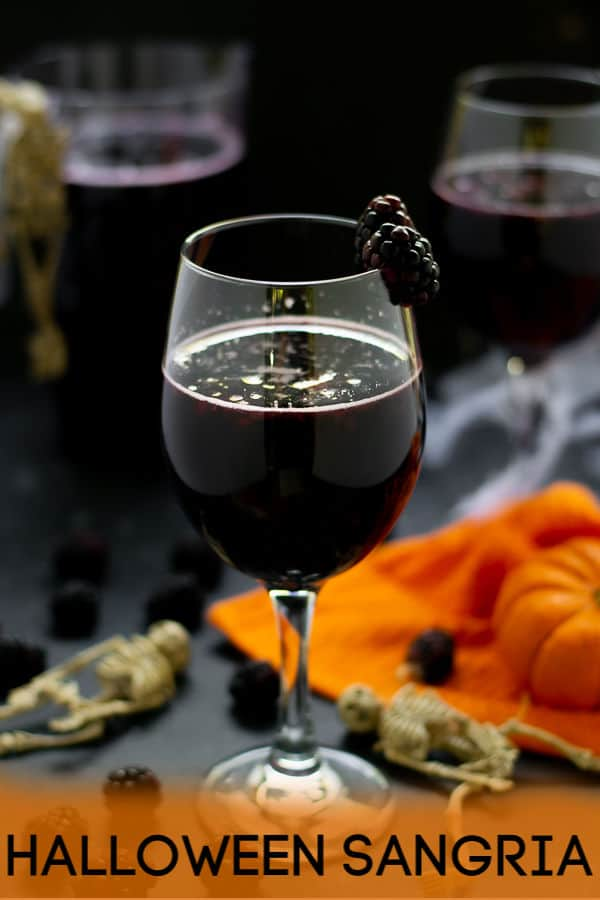 Not too sweet or overpowering this witch's brew Halloween Sangria Recipe is sure to please the adults on Halloween Night! This Black Red Wine Sangria is full of notes of blackberry and full of delicious black fruits to keep to theme. So have a Happy Halloween with this spooky Halloween Sangria! #halloweendrinks #halloweensangria #redwine #sangria #easy