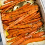 white dish full of dill roasted carrots