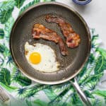 Pinterest pin for the non-stick frying pan featuring a skillet with bacon and eggs