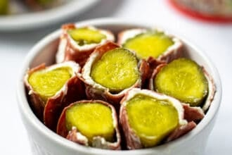 white bowl full of dried beef pickle roll ups