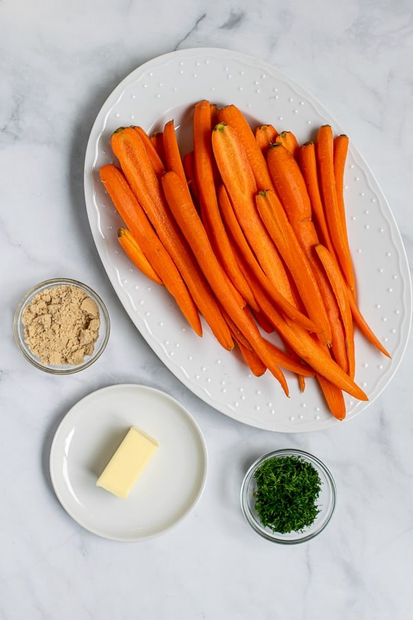 carrots halved, brown sugar, butter, and fresh dill are all the ingredients needed to make these roasted carrots