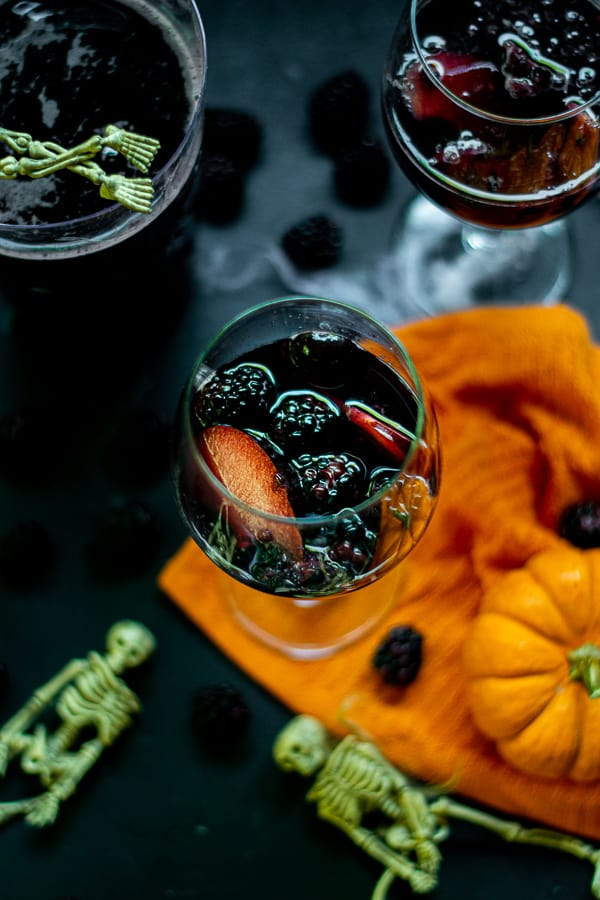 fruit in a glass with halloween sangria