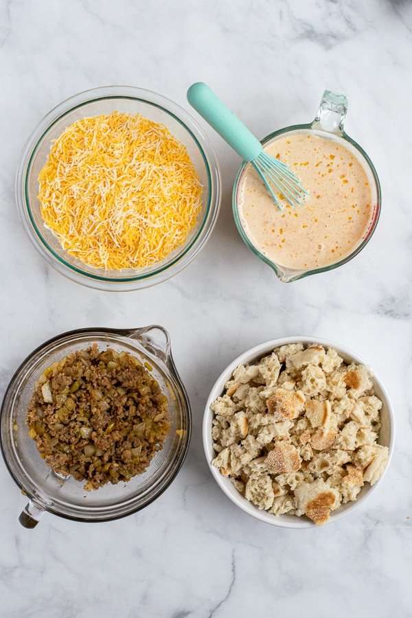 4 bowls of the prepped layers of breakfast casserole