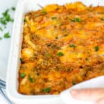 overnight tex mex breakfast casserole in a white baking dish