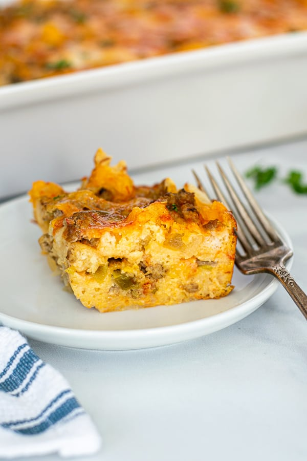 a pice of the tex-mex breakfast casserole on a small white plate