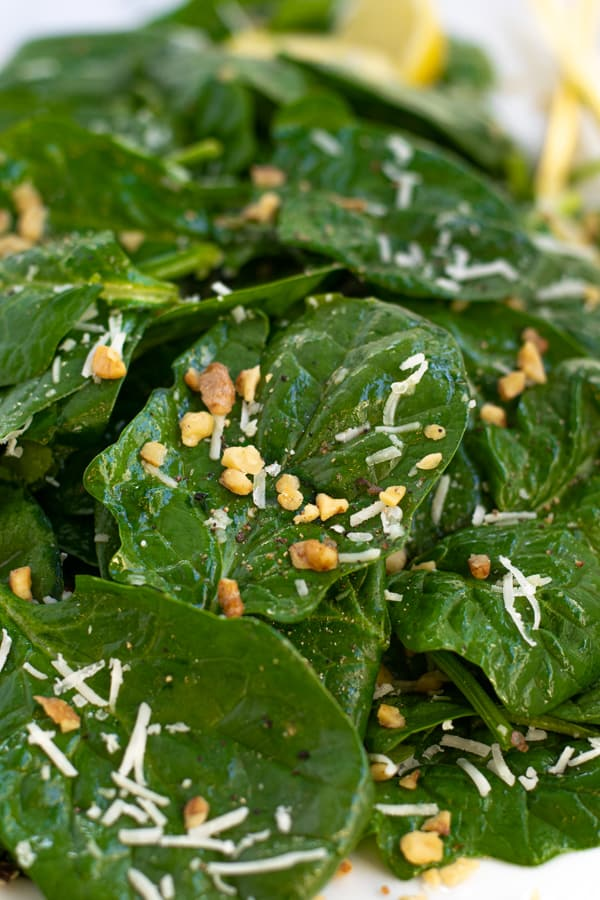 close up of a piece of spinach in the simple spinach salad