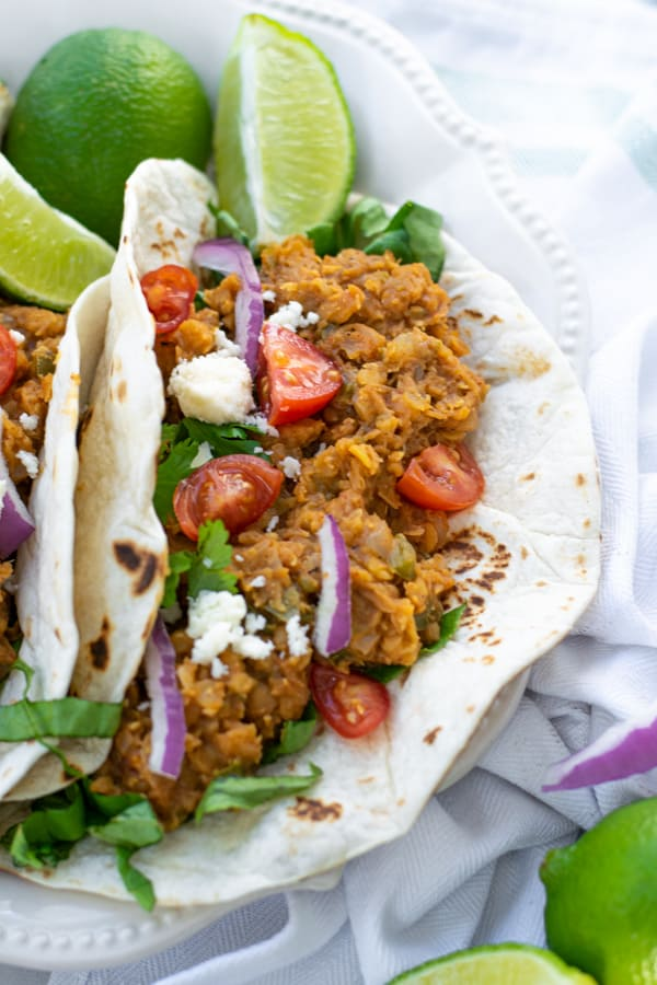 red lentil taco filling in a flour tortilla