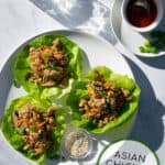 overhead shot of the Chinese Chicken Lettuce Wraps on a white plate