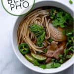 garnishes, noodles, and beef in flavorful broth made in the crockpot