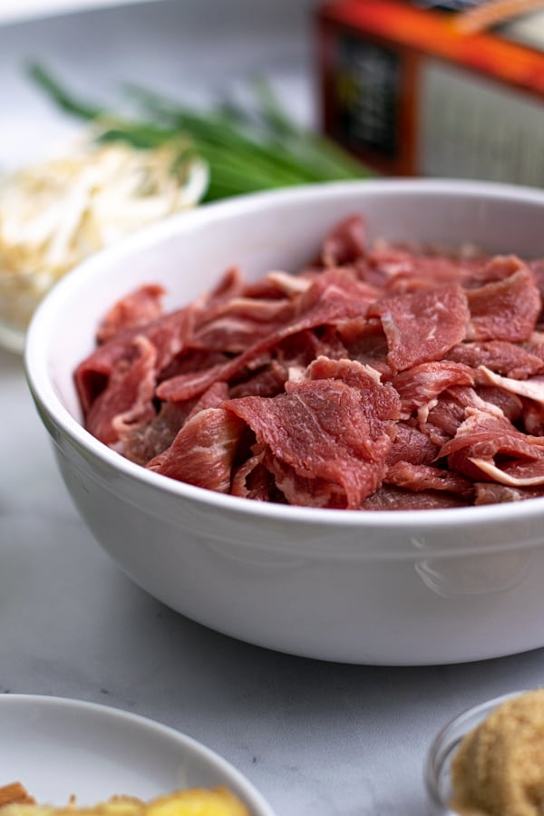 shaved steak in a bowl for the pho soup recipe