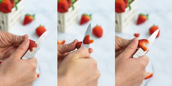 step by step photo of slicing a strawberry into a heart with a paring knife
