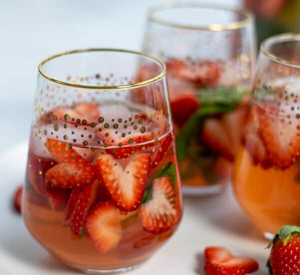 glasses of strawberry sangria with heart shaped strawberries and basil perfect for Valentine's Day, brunches, and bridal showers