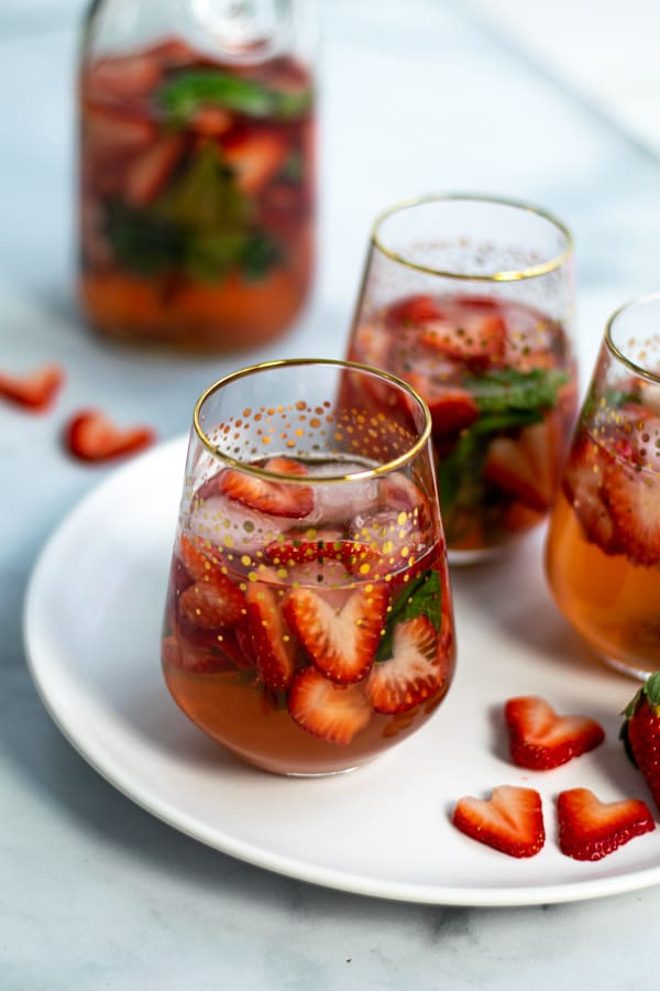 glass of strawberry sangria recipe made with rosé and strawberries