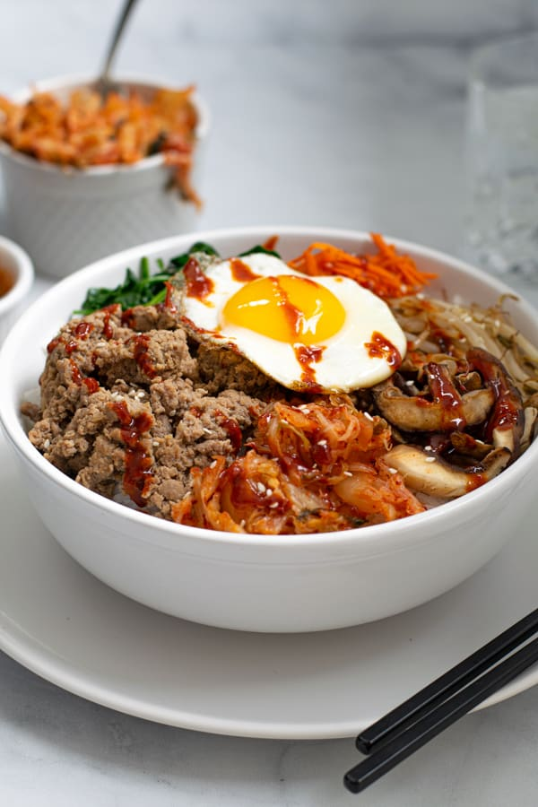 Korean Ground Turkey Bibimbap made with rice, vegetables, eggs, and kimchi