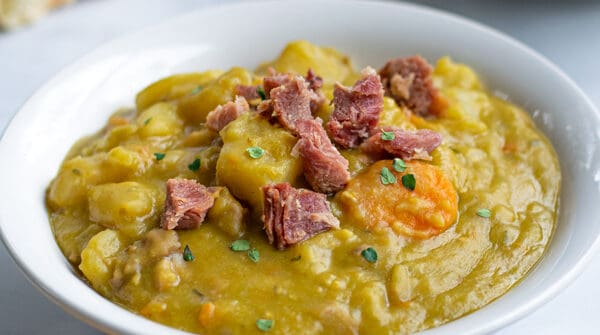close up of pressure cooker split pea soup with ham in a bowl