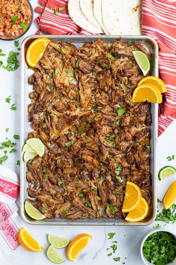 a sheet pan full of crispy crockpot carnitas recipe