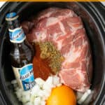 Slow Cooker Pork Carnitas Pinterest Pin showing a crockpot full of the ingredients needed