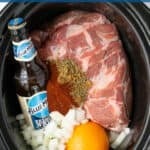 Slow Cooker Carnitas Pinterest Pin showing a crockpot full of the ingredients needed
